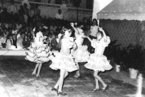 Performance of dancing in the schoolyard by girls of the school