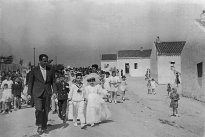 First Communion children accompanied by their teachers Joseph and Emilia in the street
